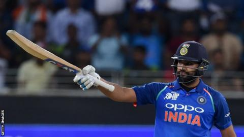 India captain Rohit Sharma raises his bat to salute the crowd after hitting fifty against Pakistan