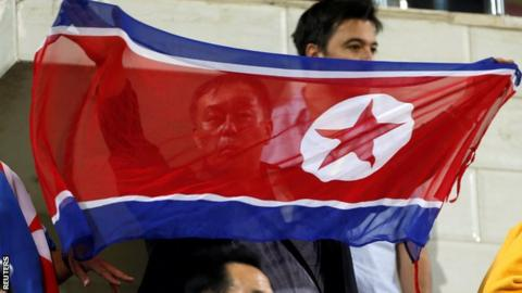 North Korean fan with flag