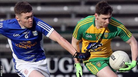 Cavan's Eoin Sommerville moves in to challenge Jamie Brennan of Donegal