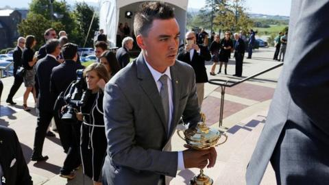 Rickie Fowler carries the Ryder Cup Trophy as he arrives for a memorial service for golfer Arnold Palmer