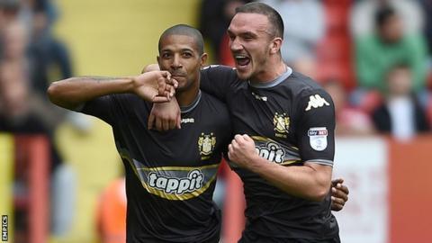 Jermaine Beckford celebrates scoring for Bury against Charlton Athletic