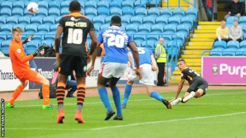Tyler Blackwood stoops to score for Newport County at Carlisle United on his debut
