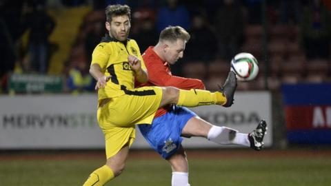 Cliftonville's David McDaid and Thomas Lambe of Ards vie for possession