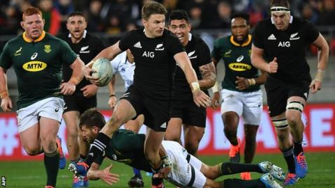 New Zealand's Beauden Barrett is tackled by South Africa's Lukhanyo Am