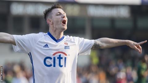 Jamie Cureton celebrates a goal