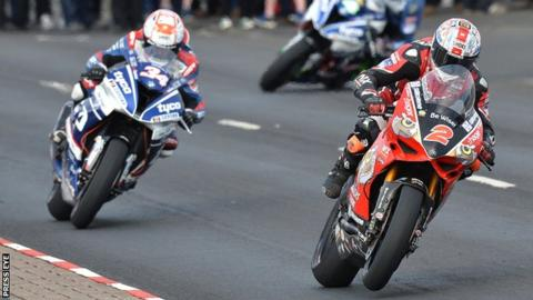 Alastair Seeley and Glenn Irwin battle in the feature Superbike race at last year's North West 200
