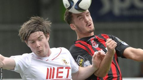 Portadown's Peter McMahon in action against Josh Robinson of Crusaders