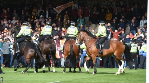 Motherwell fans ran onto the pitch following the 3-0 win