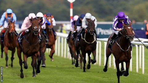 Kew Gardens and Ryan Moore (right) race to victory in the St Leger Stakes at Doncaster