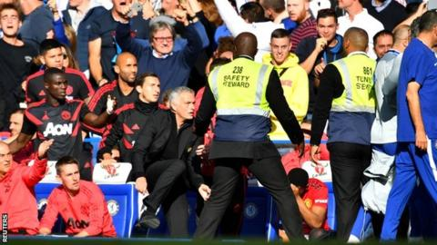 Jose Mourinho (centre) reacts to Chelsea coach Marco Ianni's celebration