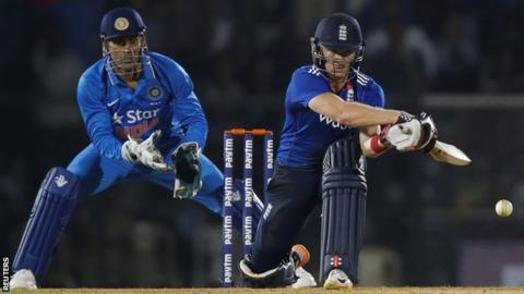 Sam Billings plays a reverse sweep against India