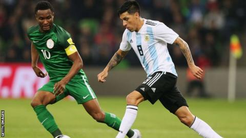 Nigeria captain John Mikel Obi (left) in action against Argentina
