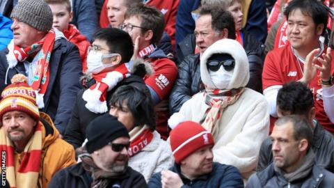 Fans wearing protective face masks during Liverpool v Bournemouth on Saturday
