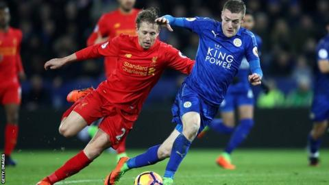 Lucas battles with Leicester's Jamie Vardy