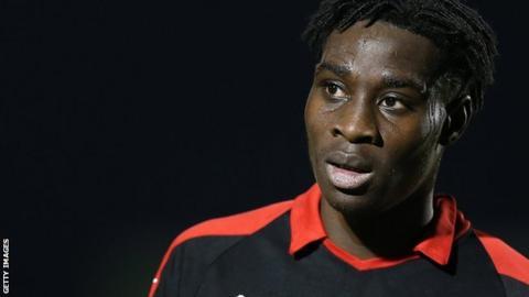 Elijah Adebayo in action for Swindon