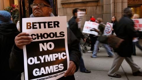 Demonstrators outside City Hall protesting against Chicago's bid to get the 2016 Olympics