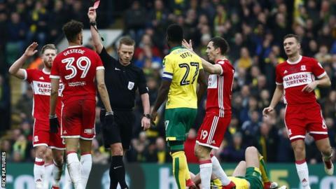 Referee Mike Jones shows Middlesbrough striker Rudy Gestede a straight red card
