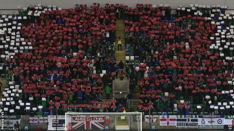 Northern Ireland supporters used cards to create the shape of a poppy