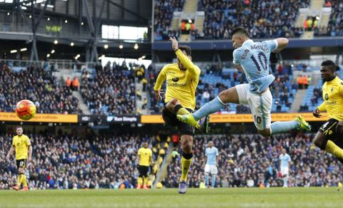 Sergio Aguero scores Manchester City's third goal against Aston Villa
