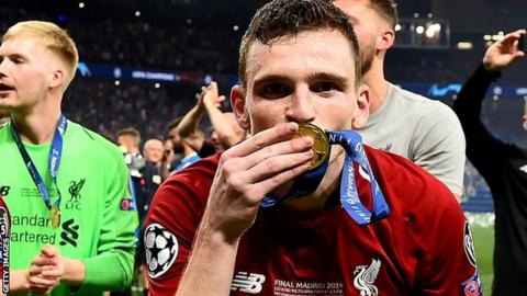 Andy Robertson kisses his Champions League winners medal