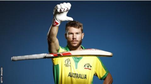 David Warner drops his bat in a photo session