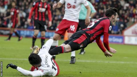 Adam Smith (right) falls under the tackle of Sofiane Boufal