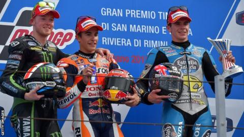 Spaniard Marc Marquez (centre) celebrates his San Marino Moto GP victory on the podium with Honda team-mate Scott Redding (right) and Yamaha's Bradley Smith