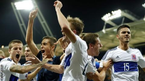 Luxembourg's players celebrate at full-time