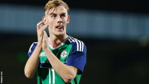 Mark Sykes in action for Northern Ireland Under-21s