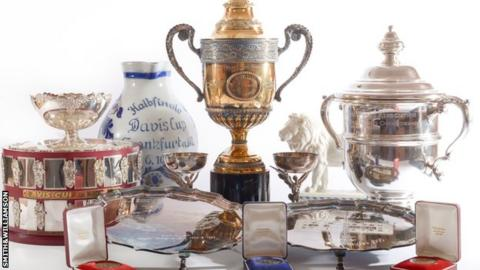 Becker auctions trophies, raises over £680,000