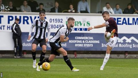 Hearts midfielder Olly Lee scores