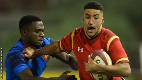 Wales and Ospreys wing Keelan Giles (right) is tackled by Eliott Roudil of France