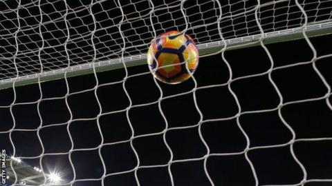 A ball hits the back of the net