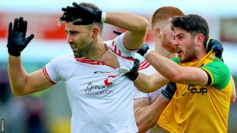 Ryan McHugh shows his anger with Tiernan McCann after the Tyrone man appeared to put his fingers in the face of Donegal man Stephen McMenamin and also stamp on the defender