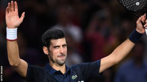 Novak Djokovic celebrates beating Kyle Edmund