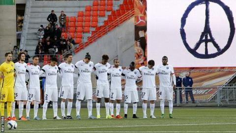 Paris St Germain players observe a minute's silence ahead of their win at Lorient