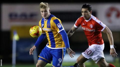Stephen Humphrys holds off a challenge from Charlton's Jorge Teixeira