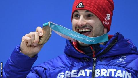 Britain's bronze medallist Dom Parsons poses on the podium during the medal ceremony for the men's skeleton at the Pyeongchang Medals Plaza during the Pyeongchang 2018 Winter Olympic Games