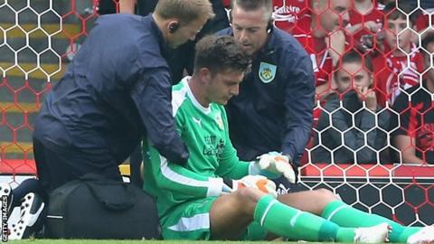 Nick Pope suffers a shoulder injury at Aberdeen