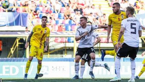 Romania's George Puscas (second right) has scored four goals - including three penalties - at the European Under-21 Championship
