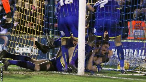 Paul Robinson scores for AFC Wimbledon against Carlisle