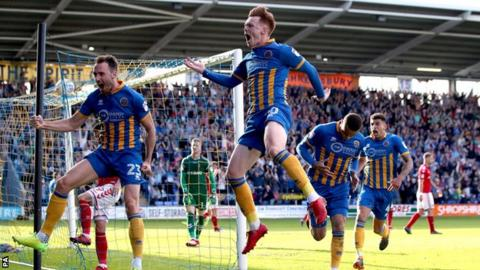Shrewsbury Town's players celebrate their winner in the play-off second leg against Charlton