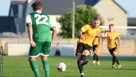 Ben Swallow takes a shot for Newport against Barry Town Utd