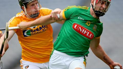 Antrim defender Tony McCloskey challenges James Toher in Saturday's final replay