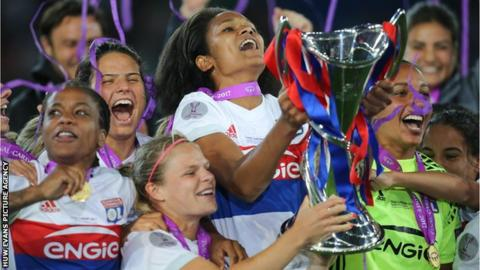 Olympique Lyonnais players with the Uefa Women's Champions League trophy
