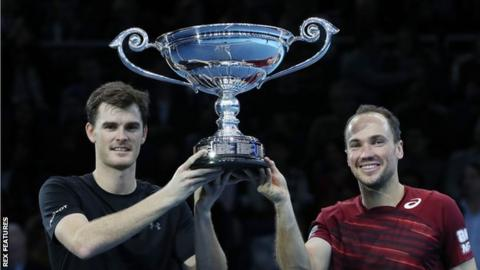 Jamie Murray (left) and Bruno Soares hold aloft their trophy for ending the season as the world number one doubles pairing, despite losing in London
