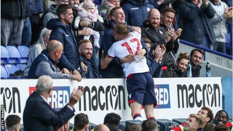 Bolton Wanderers' Craig Noone celebrates scoring his side's first goal with former team mate Stephen Darby