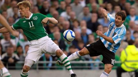 Lionel Messi battles with the Republic of Ireland's Damien Duff during the 2010 friendly