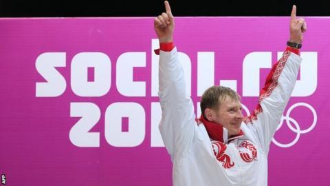 Bobsleigher Aleksandr Zubkov celebrates winning a gold medal at Sochi 2014