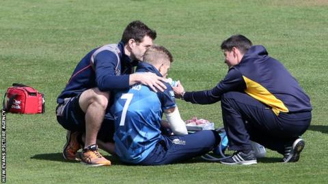 Sam Billings receiving treatment